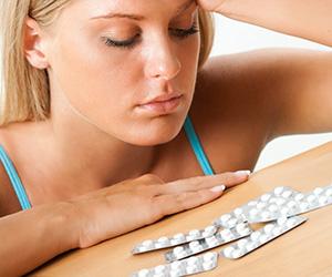 sad-girl-with-pills