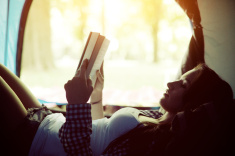 stock-photo-42747622-beautiful-young-woman-reading-a-book-in-a-tent